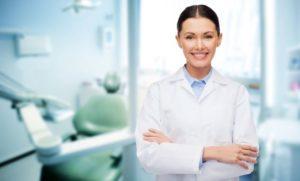 Dental professional smiling in camera